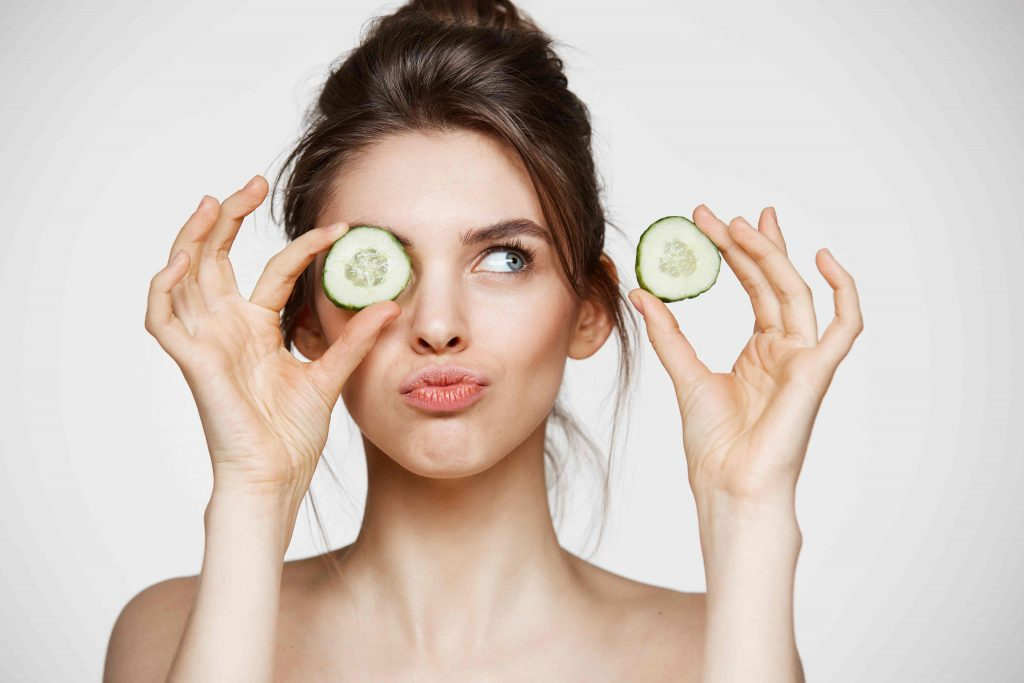 young beautiful naked girl smiling hiding eye cucumber slice white background beauty spa cosmetology concept